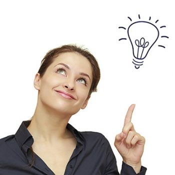 Beautiful business woman with idea light bulb above hand isolated on white background
